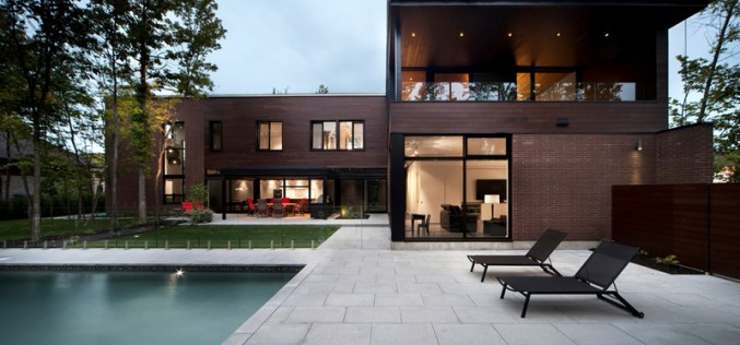 A Family Home In A Forest Setting Covered In Local Clay Bricks And Cedar