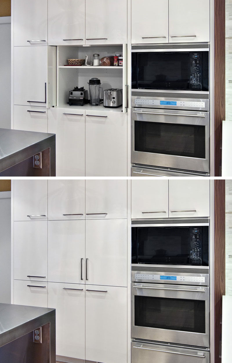 Kitchen Design Idea - Store Your Kitchen Appliances In A Dedicated Appliance Garage // This appliance garage is tall enough to include a second shelf that holds some of the things you'd likely need when using the appliances in the cupboard.