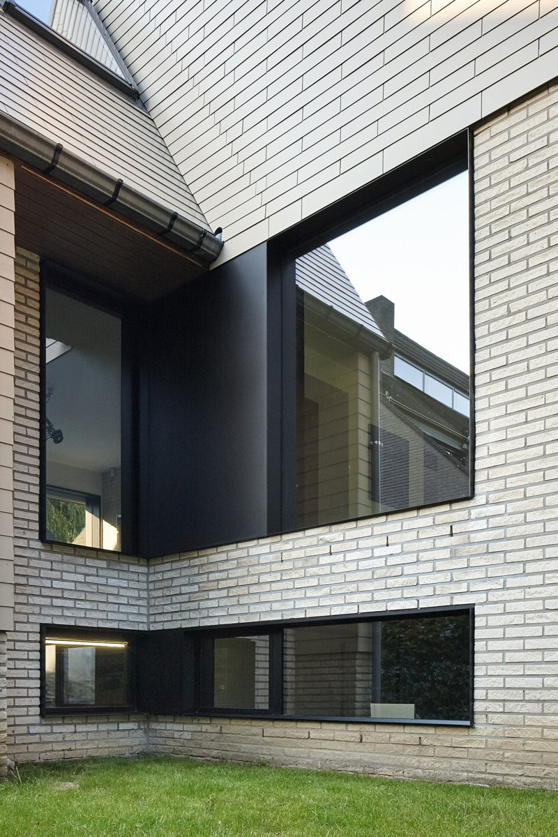 Black framed windows were included in the renovation of this brick home.