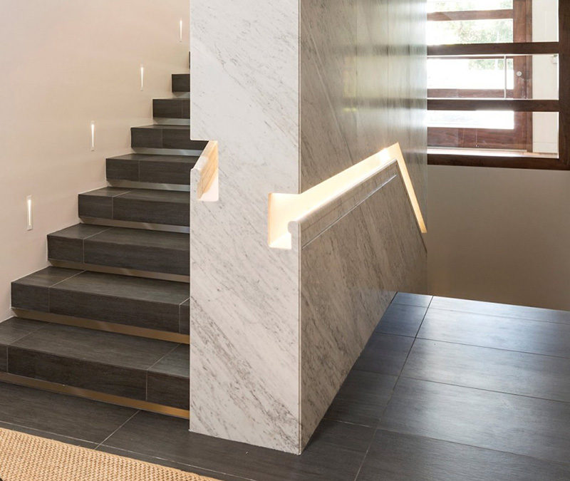 Stair Design Idea - 9 Examples Of Built-In Handrails // In this home, the stair handrail was first built into the wall, which was then clad in marble.
