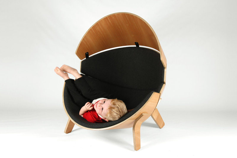 12 Comfy Chairs Perfect For Relaxing In // This wood framed chair is lined with felt-covered cushions to create a quieter and more relaxing place for kids to get comfy and unwind in.