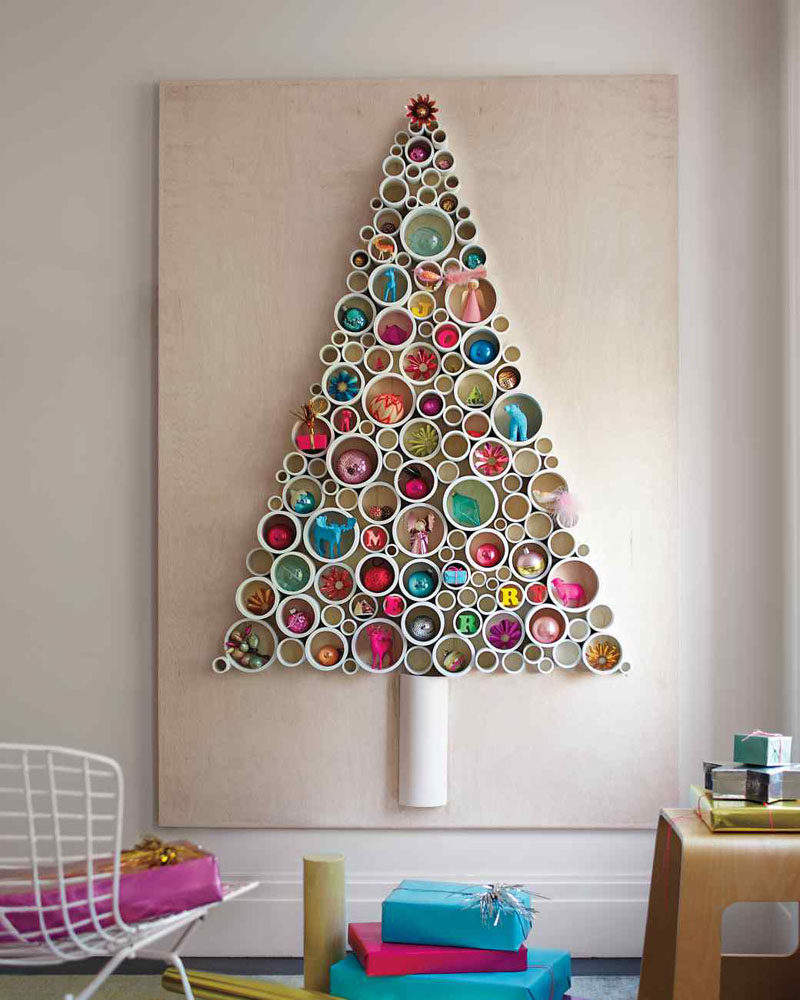 Christmas Decor Ideas - 14 DIY Alternative Modern Christmas Trees // Thin slices of PVC pipe have been attached to a sheet of plywood and filled with fun ornaments to create a festive Christmas tree alternative that can be used year after year.
