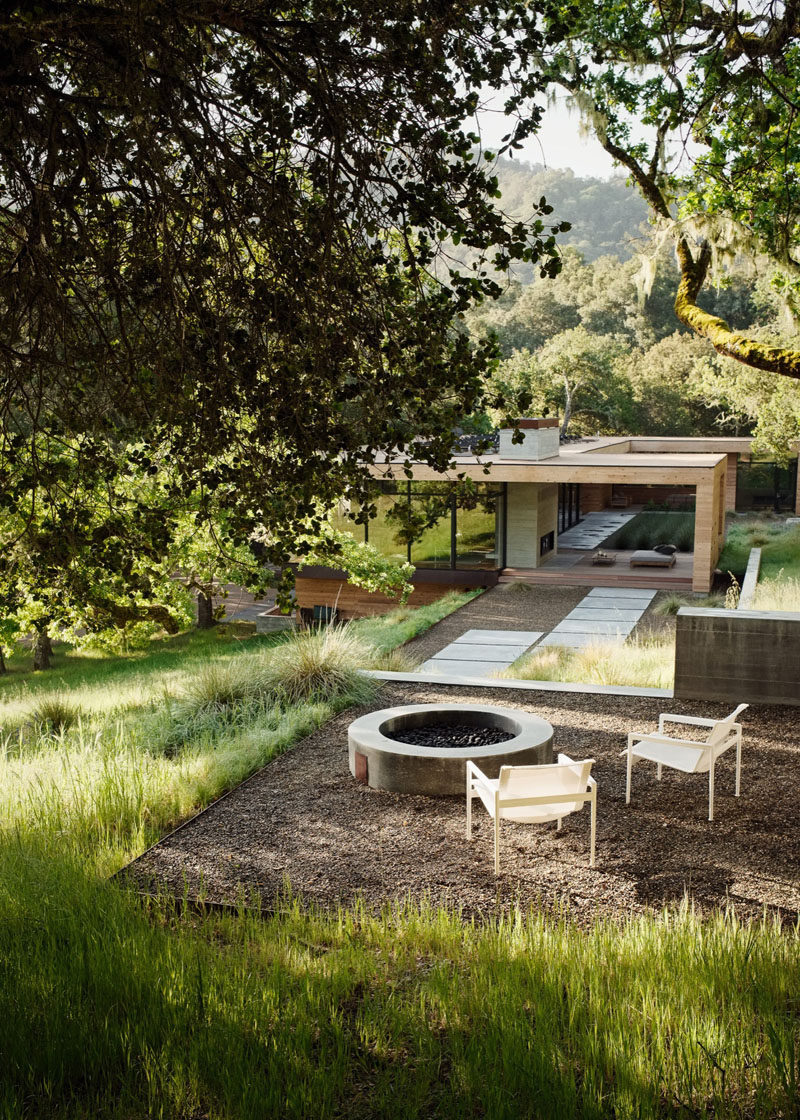 This home has a firepit that reached by a landscaped path.