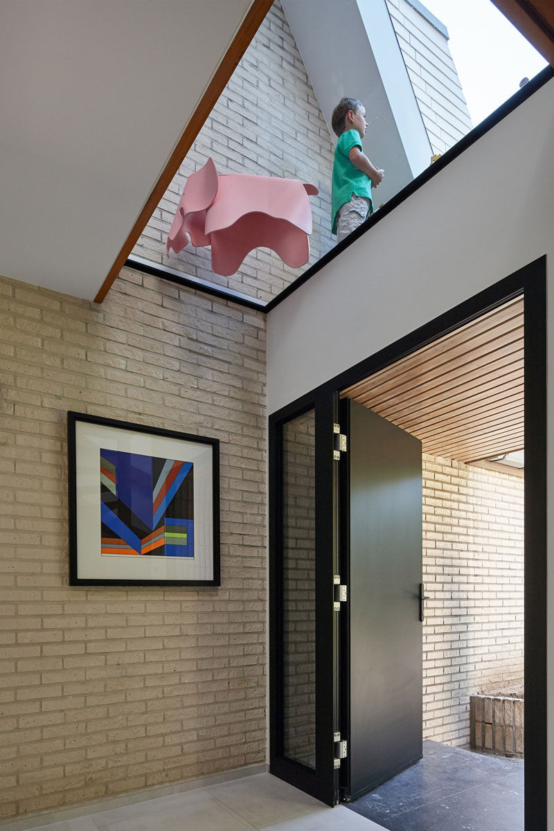 Just inside the front door of this renovated home, a skylight is now present to light up the entry of the home.