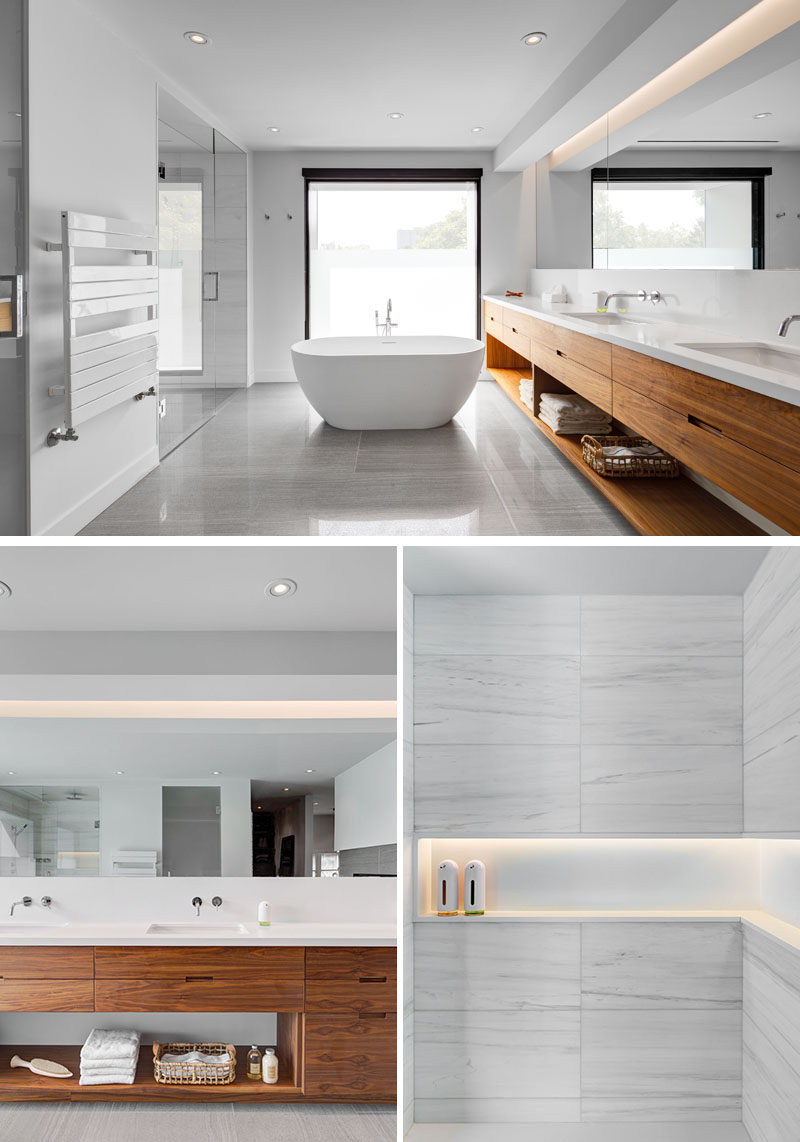 In this master bathroom there's a enclosed enclosed walk-in shower, a standalone bathtub and a large dual-sink vanity that runs the entire length of the wall.