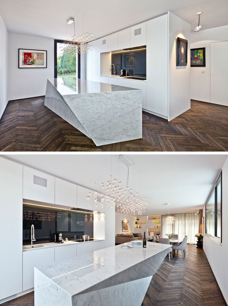 16 Inspirational Pictures Of Herringbone Floors // The dark, rich wooden herringbone floor creates warmth in this mostly-white home.