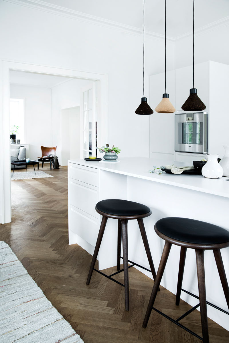 16 Inspirational Pictures Of Herringbone Floors // The dark wood herringbone floor in this apartment warms up the all white interior.
