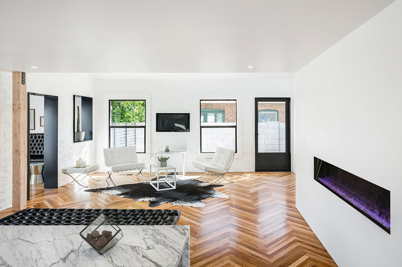 16 Inspirational Pictures Of Herringbone Floors // This herringbone design was created by using salvaged wood floors that were ripped out during the renovation.