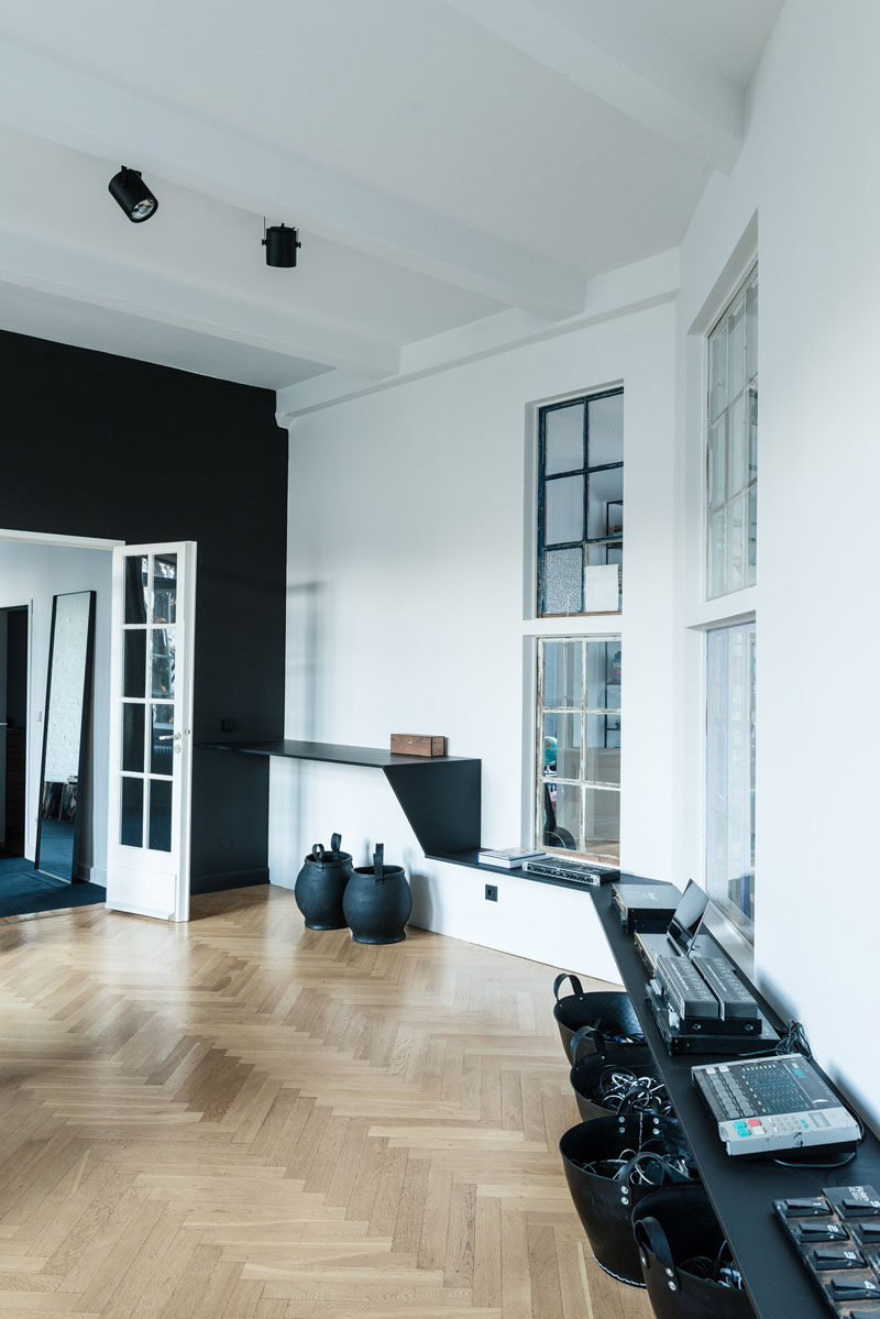 16 Inspirational Pictures Of Herringbone Floors // This studio/loft has light wood herringbone floors to warm up the black and white interior.