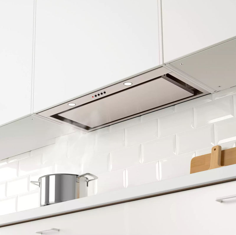 Kitchen Design Idea - Hide The Range Hood // A fake cabinet conceals this range hood that can only be seen when looked at from underneath.