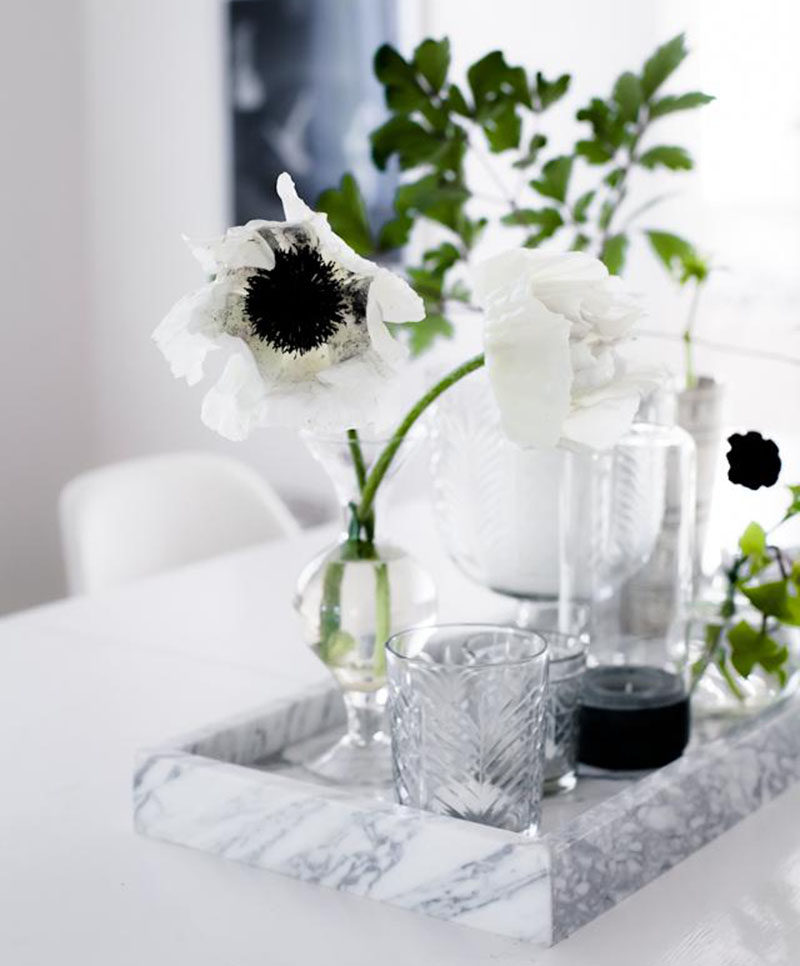 Home Decor Ideas - 6 Ways To Use Serving Trays In Your Decor // In the dining room, decorated with glassware and flowers.