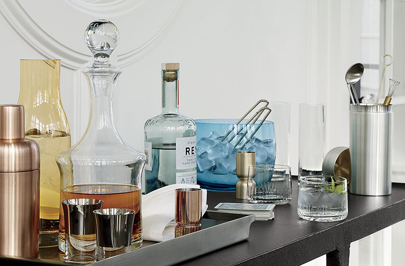 Home Decor Ideas - 6 Ways To Use Serving Trays In Your Decor // On the bar, decorated with cocktail shaker, drinks and shot glasses.