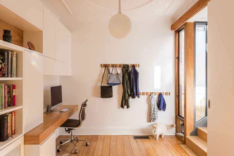This small home office is built into the entryway of this home.