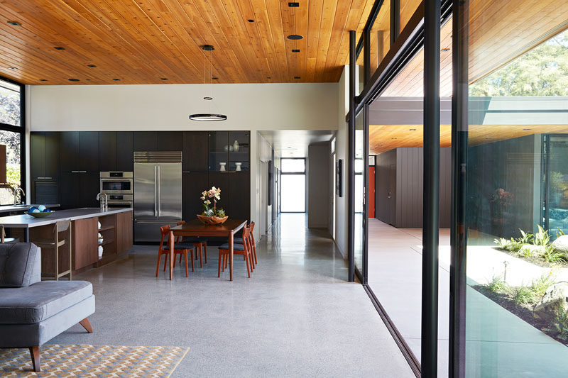 A large wall of glass wall can be opened to make the main living area in this home ideal for indoor/outdoor living.