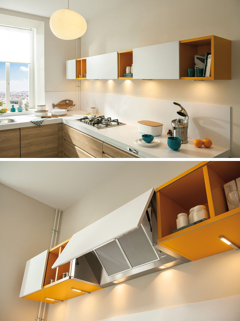 Kitchen Design Idea - Hide The Range Hood // The door covering this range hood matches the other white cabinet doors on this yellow shelving unit effectively hiding the hood and and blending it in with the rest of the kitchen.
