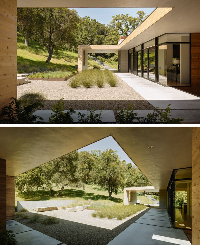 This 'L' shaped home has a large landscaped area with organized landscaping.