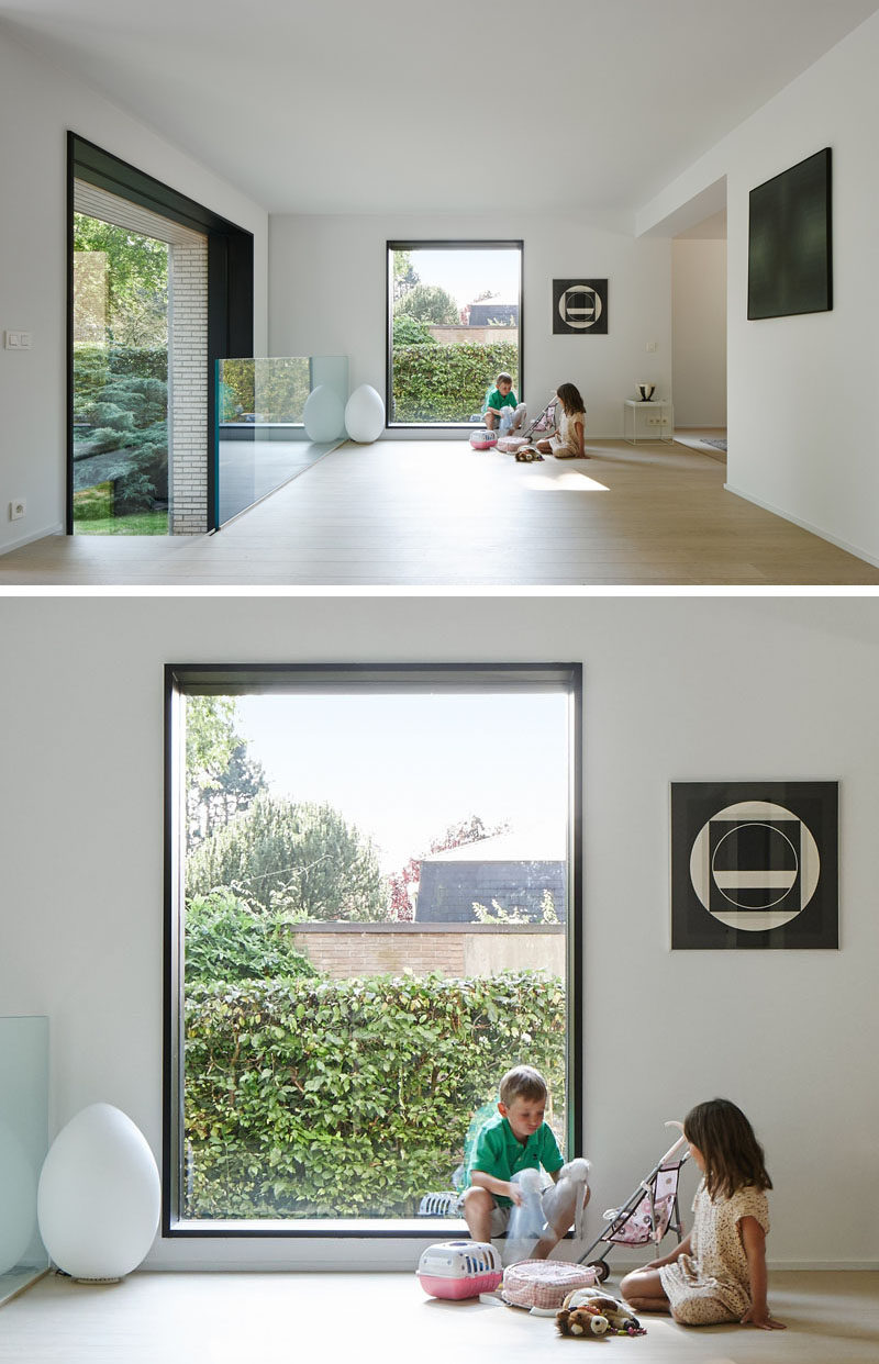 Black framed windows and light wood floors have been included in the updated design of this home.