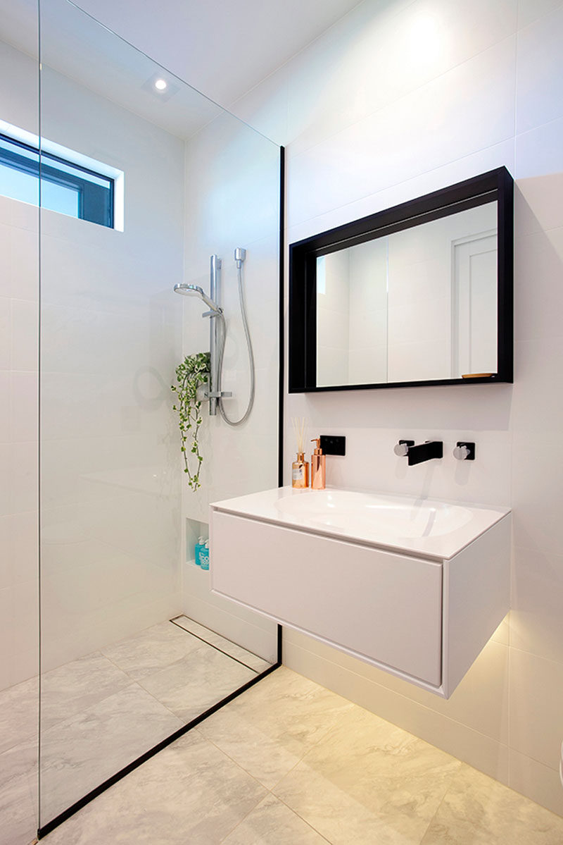 This bathroom has a vanity with hidden lighting underneath to keep the bathroom looking bright.