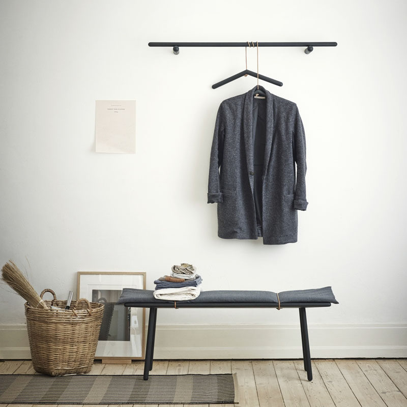 Entryway Design Ideas - 3 Different Styles Of Entryway Benches // A simple bench with light padding and a matching coat rack make this small entryway look put together and very minimal.