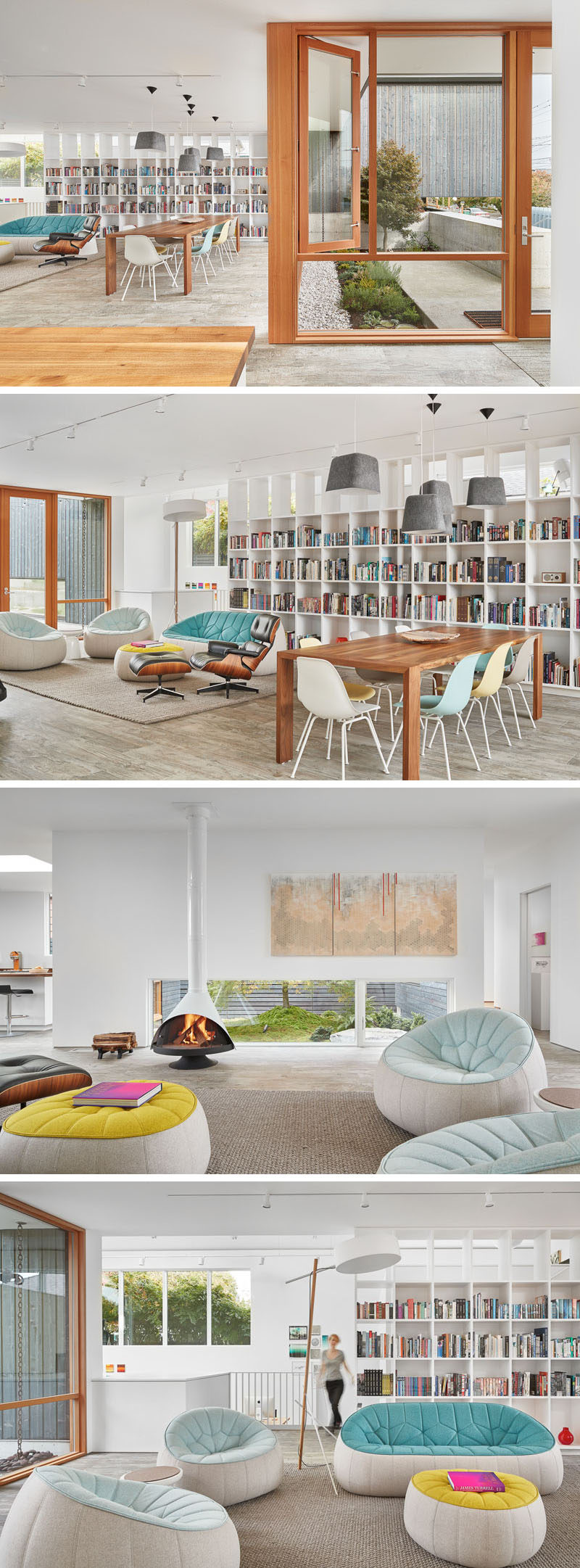 Inside this modern home, the living room has a wall of custom bookshelves, comfortable sofas and a wooden dining table surrounded by colored chairs.