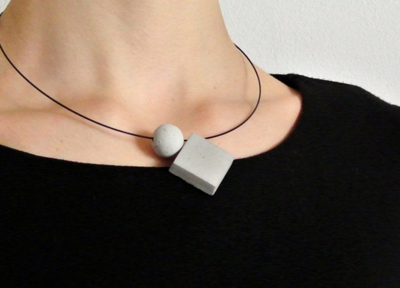 The Ultimate Gift Guide For The Modern Woman (40 Ideas!) // Concrete geometric pendants on a matte black necklace make a simple statement and can be dressed up and down.