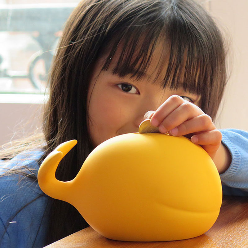 Gift Guide - 30+ Gift Ideas For The Modern Kid In Your Life // Piggy Banks - This matte yellow whale bank looks great while letting your kids save money.