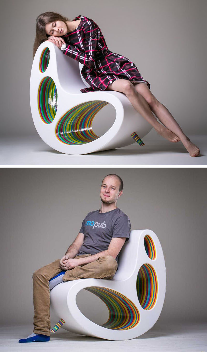 Furniture Ideas - 14 Awesome Modern Rocking Chair Designs // Colorfully painted wood can be seen through the holes in the body of this rocking chair and on the front peg that can be removed for more intense rocking.