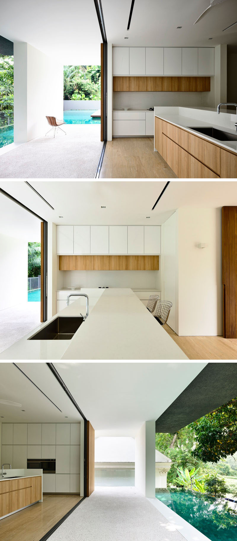 The entire length of this white and wood kitchen is open to the swimming pool.