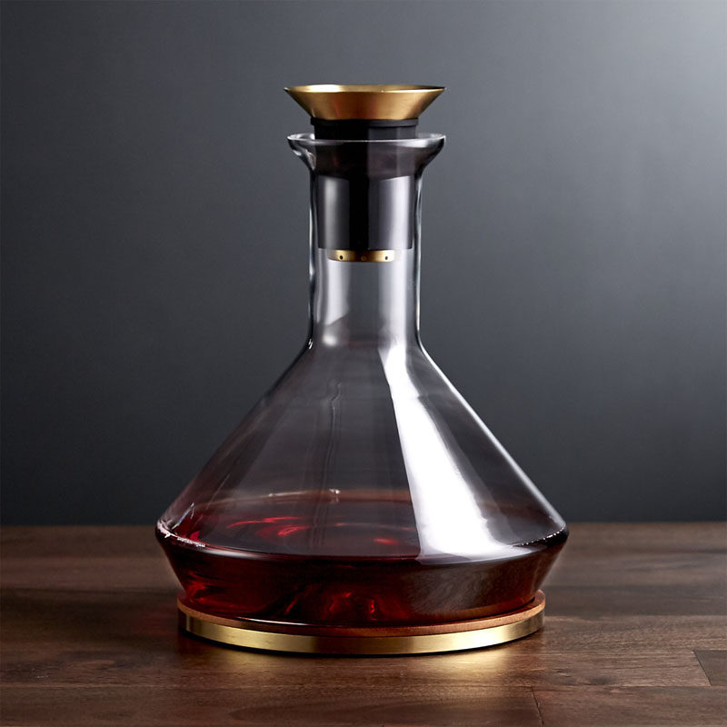 10 Unique Modern Wine Decanters // Pour your bottle of wine into this glass and brass decanter that features a filter for catching sediments and a wood base to catch any drips.