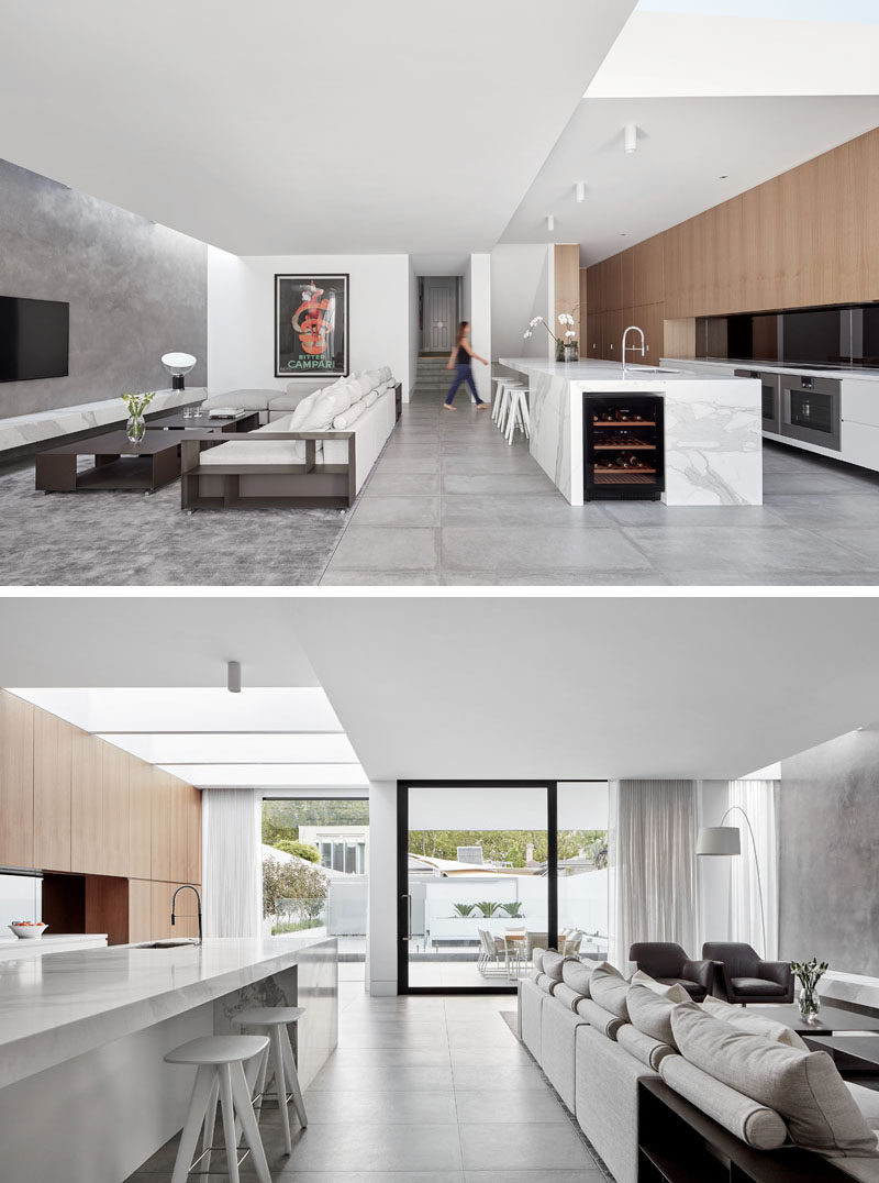 In this new house extension, a large open floor plan has been created with the space split evenly between the living room and the kitchen.