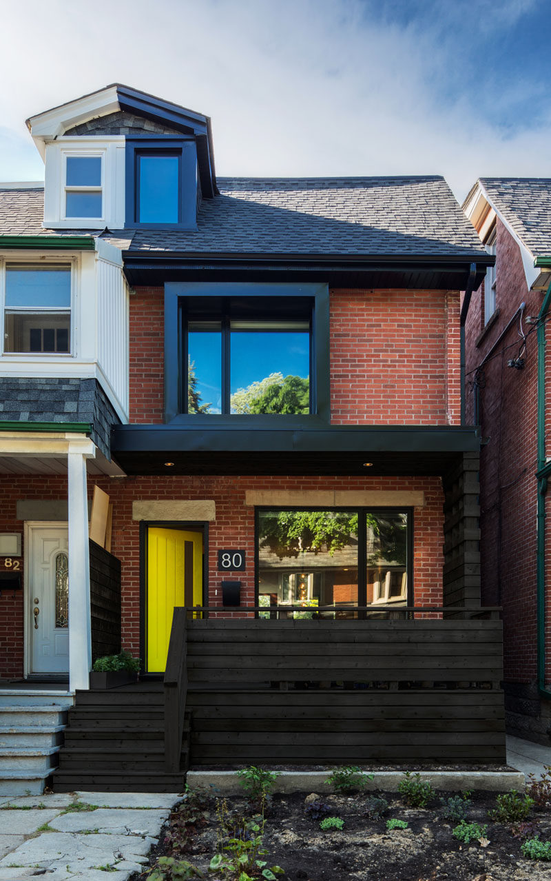 Post Architecture have updated this semi-detached home in Toronto, Canada, that was originally a mirror image of its attached neighbor.
