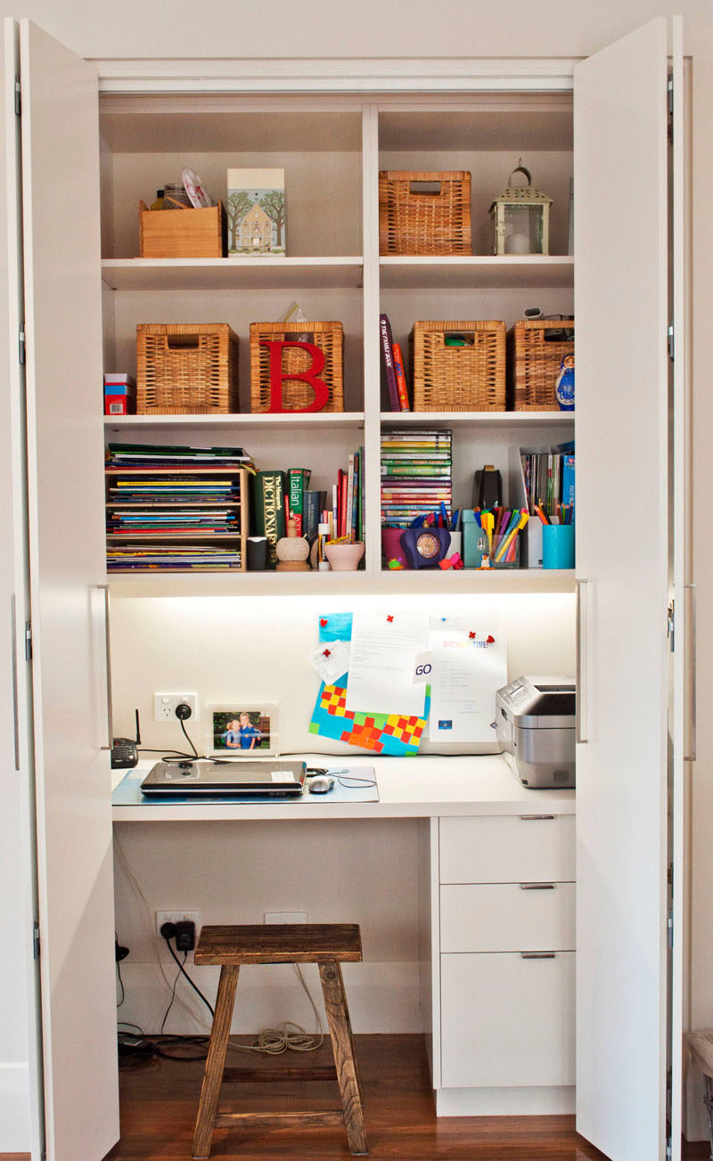 Small Apartment Design Ideas - Create A Home Office In A Closet // This closet acts as the family command center, keeping the phone, printer, books, computer, and other essentials in one convenient place that can be completely hidden in a matter of seconds.