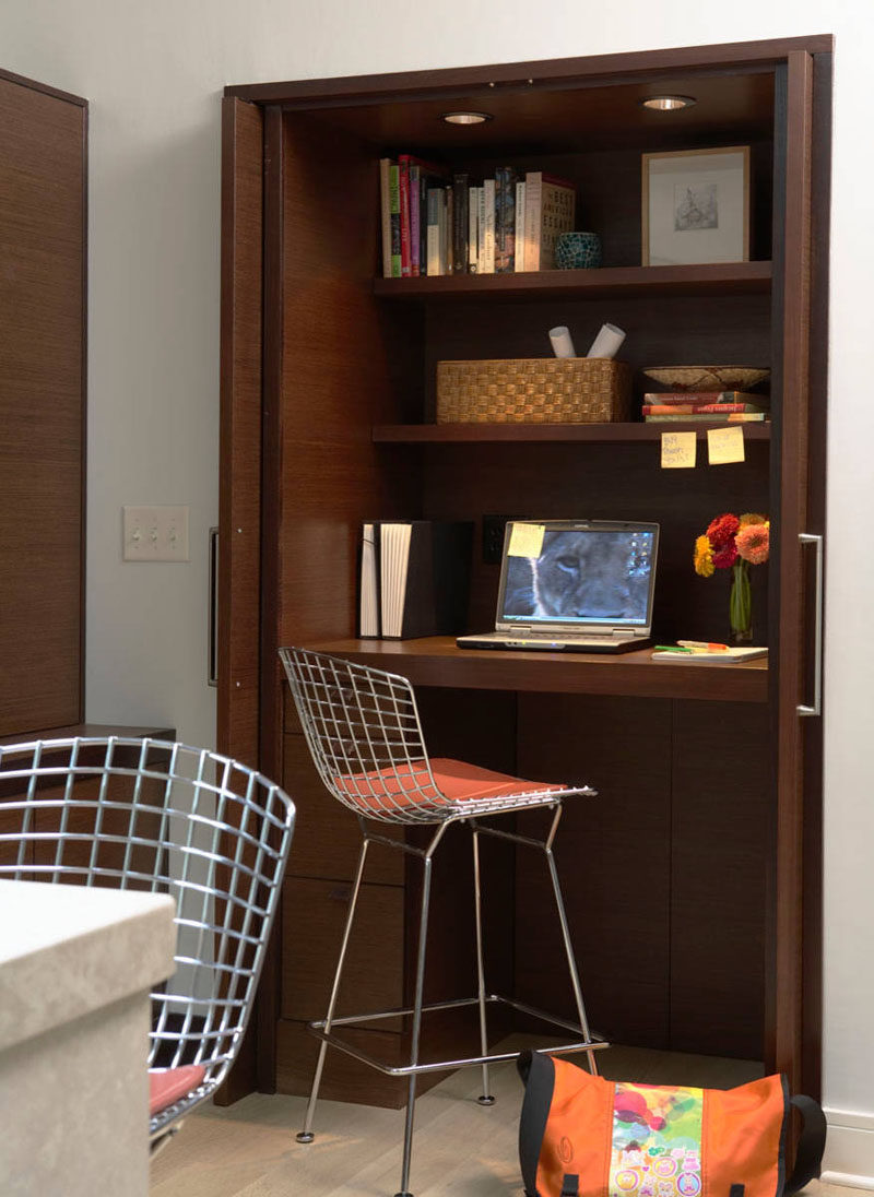 Small Apartment Design Ideas - Create A Home Office In A Closet // The desk of this closet office is raised up to create more leg space and provide more drawer storage underneath.