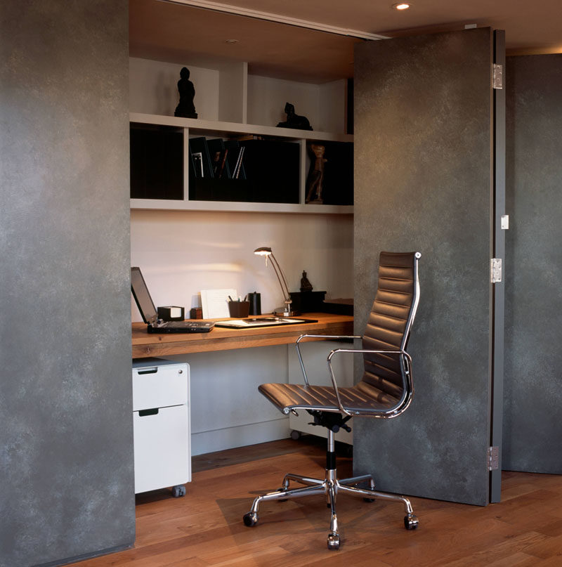 Small Apartment Design Ideas - Create A Home Office In A Closet // A long thick slab of wood makes up the desk of this compact home office, which can be quickly hidden when it's no longer in use.
