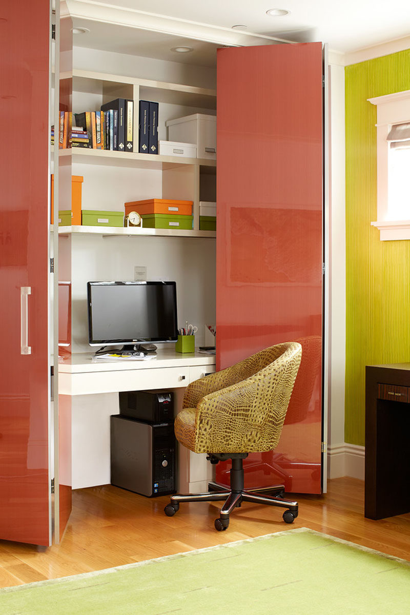 Small Apartment Design Ideas - Create A Home Office In A Closet // Colorful doors conceal this home office with built-in shelves when it isn't being used.