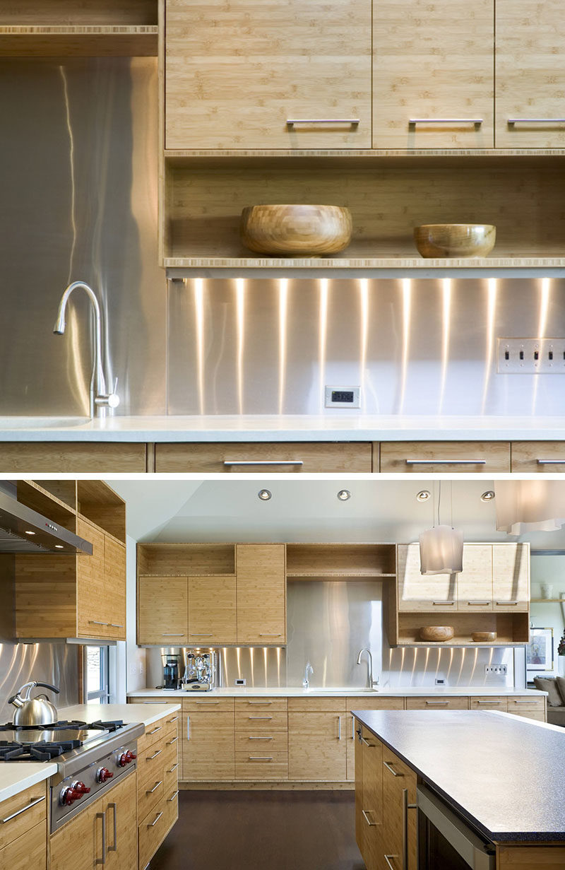 Kitchen Design Idea - Stainless Steel Backsplash // Bright, shiny stainless steel covers the backsplash areas of these kitchen walls to create a clean and modern look.