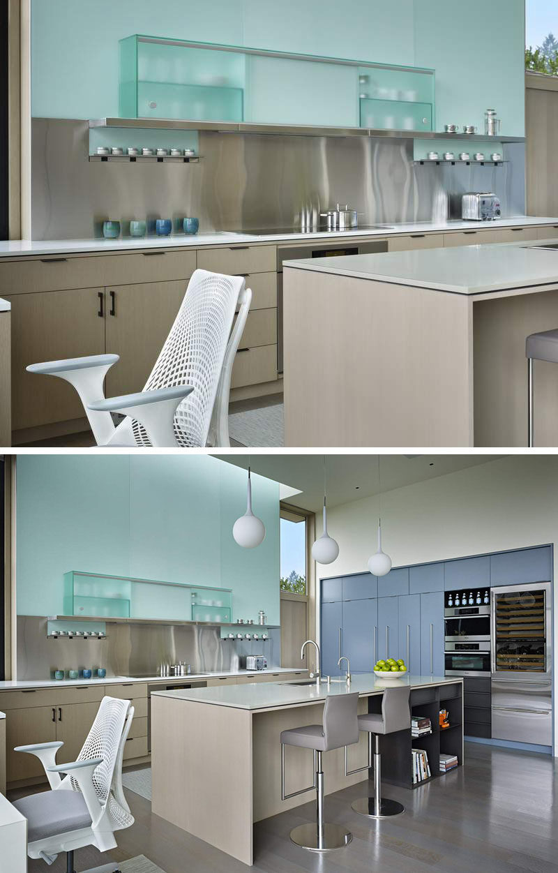 Kitchen Design Idea - Stainless Steel Backsplash // The stainless steel backsplash in this kitchen contributes to the almost futuristic look of the space.