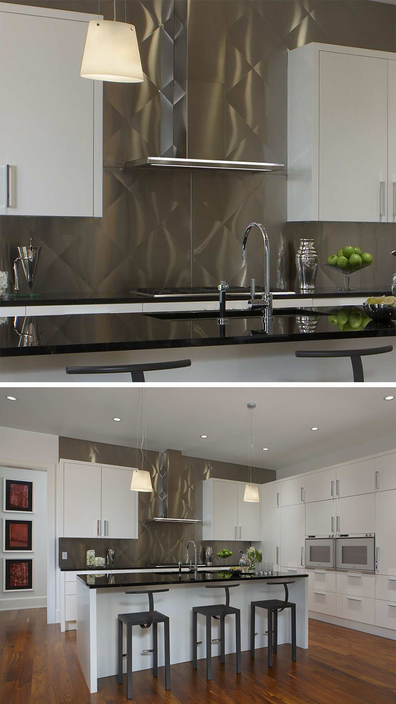 Kitchen Design Idea - Stainless Steel Backsplash // Stamped panels of stainless steel add texture to this metallic backsplash and break up the white cabinetry.