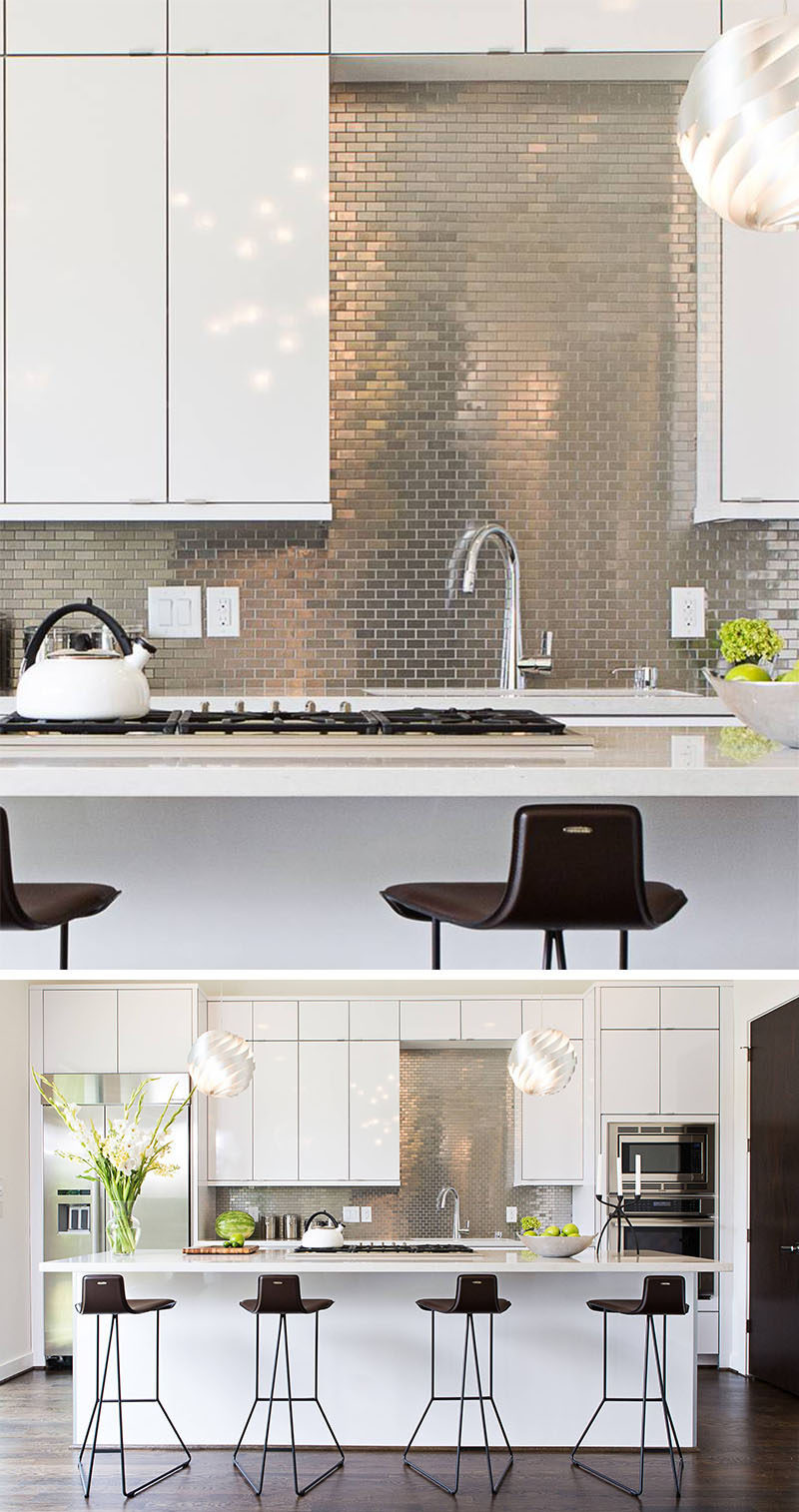Kitchen Design Idea - Stainless Steel Backsplash // Small stainless steel tiles have been arranged in a brick-like pattern to contrast the white cabinetry and to help brighten the kitchen.