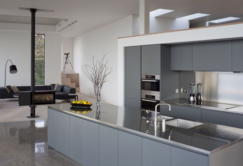 Kitchen Design Idea - Stainless Steel Backsplash // The stainless steel backsplash in this kitchen matches the stainless steel countertops and contrasts the matte grey cabinetry.