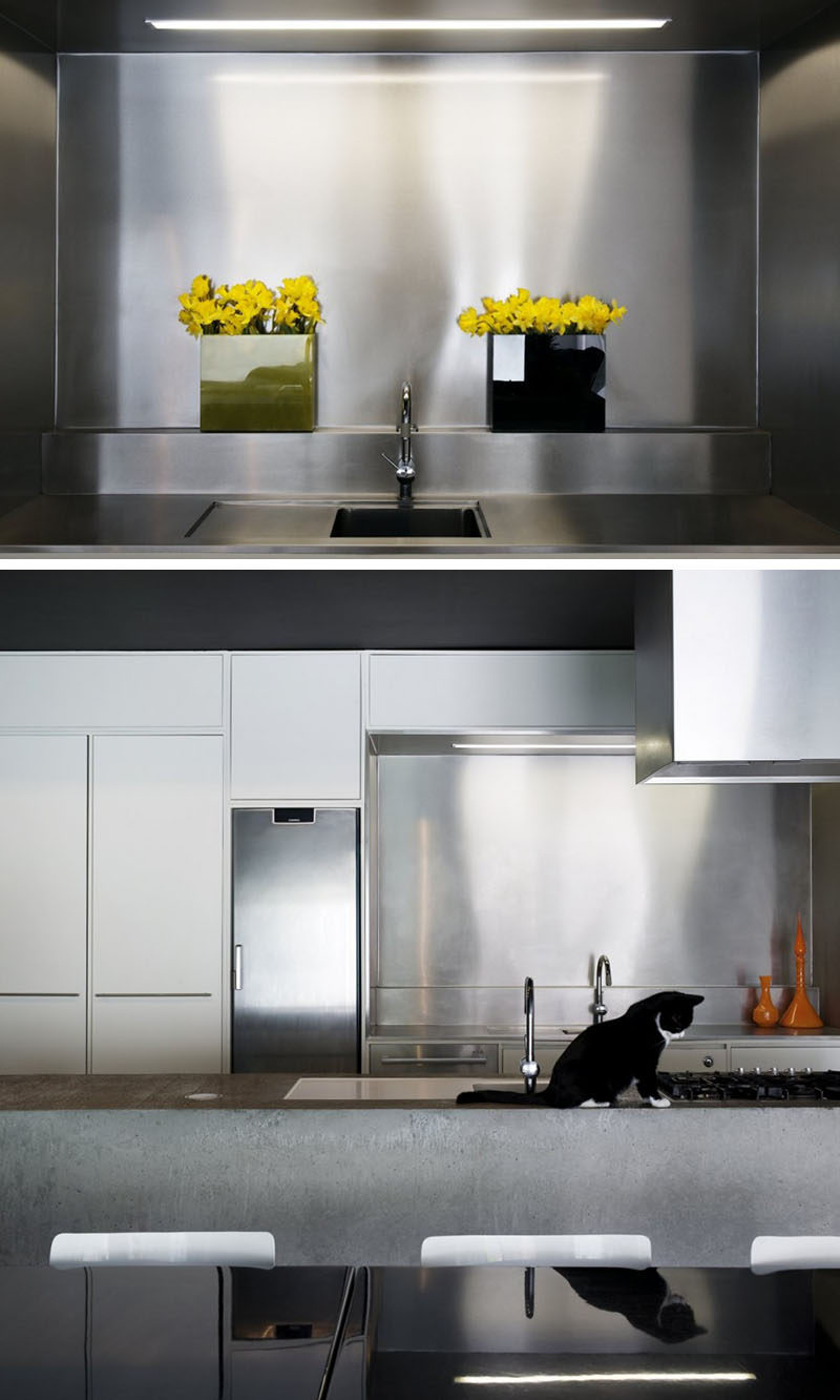 Kitchen Design Idea - Stainless Steel Backsplash // The combination of the stainless steel backsplash and the concrete island make for a durable, contemporary kitchen.
