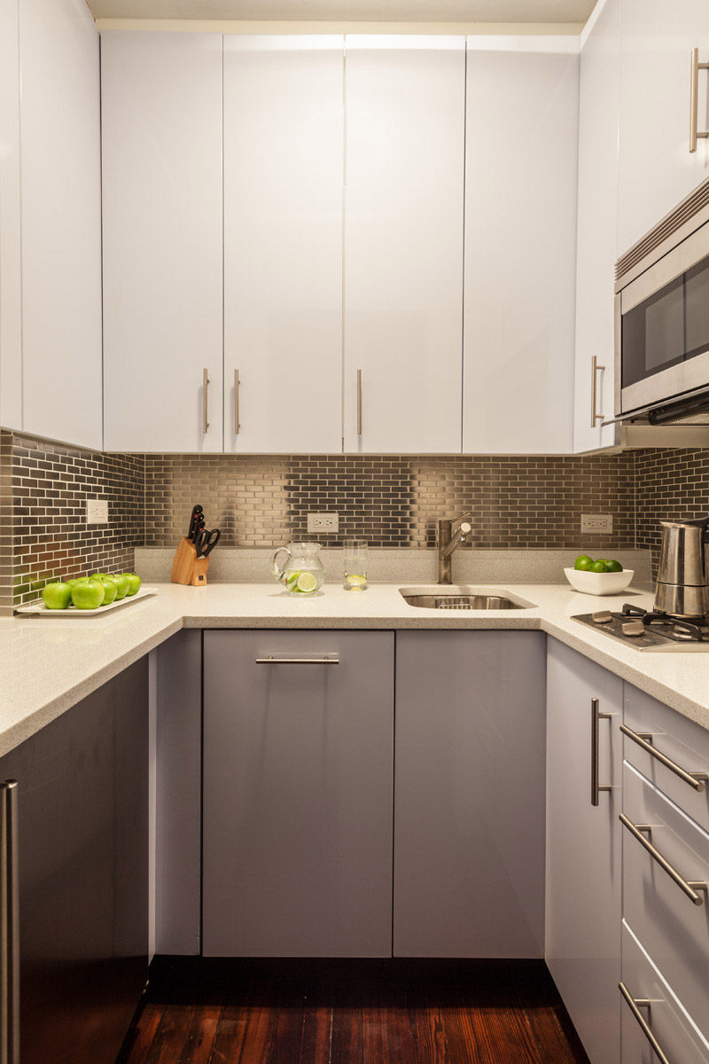 Kitchen Design Idea - Stainless Steel Backsplash // The brick-like arrangement of these stainless steel tiles adds texture and brightness to this tiny kitchen.