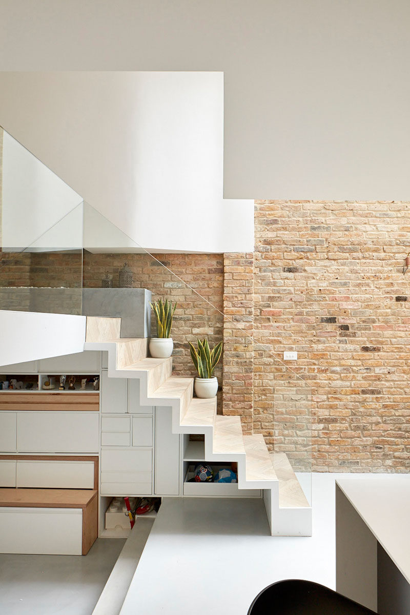 Storage nooks and drawers have been designed specifically to hide under these stairs.