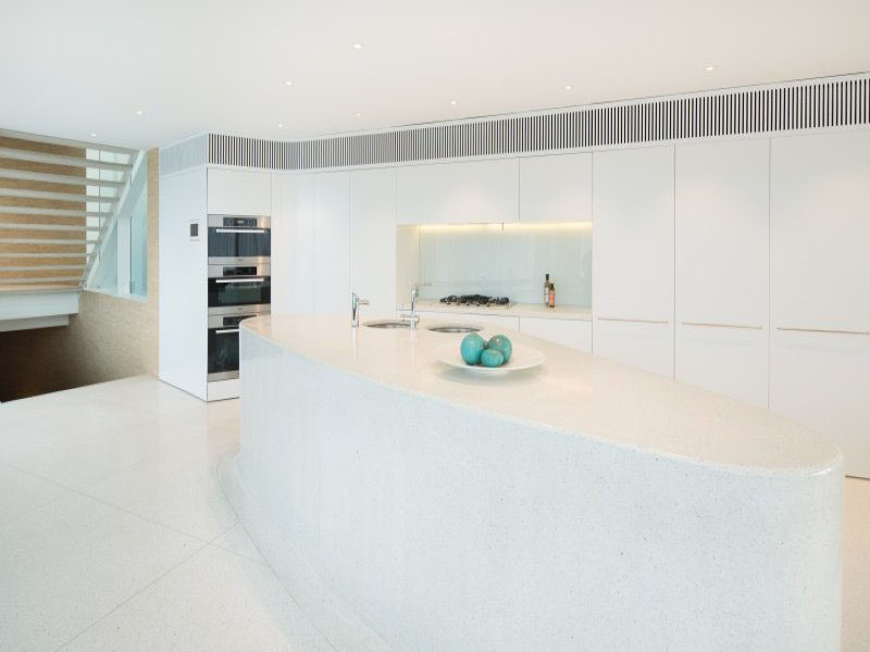 Kitchen Design Ideas - White, Modern and Minimalist Cabinets // Everything except for the appliances is white in this super clean, bright kitchen.