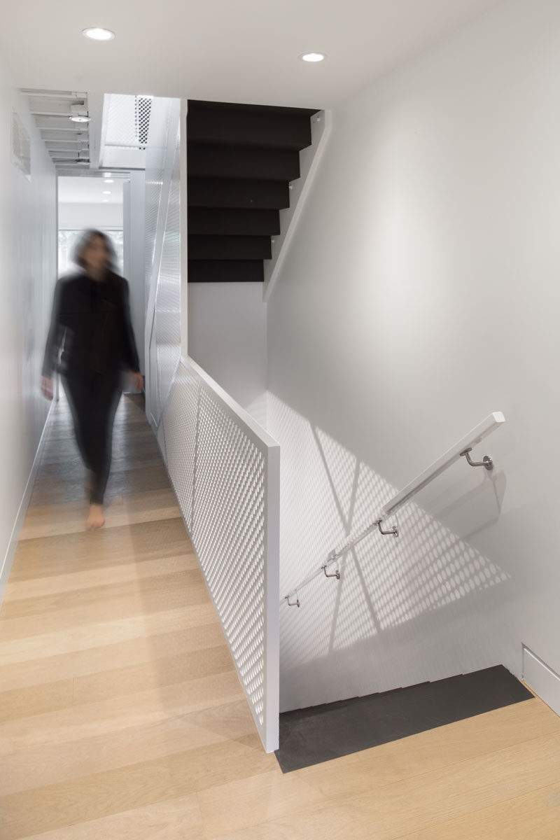 These dark stairs provide a strong contrast to the rest of the bright and light interior.