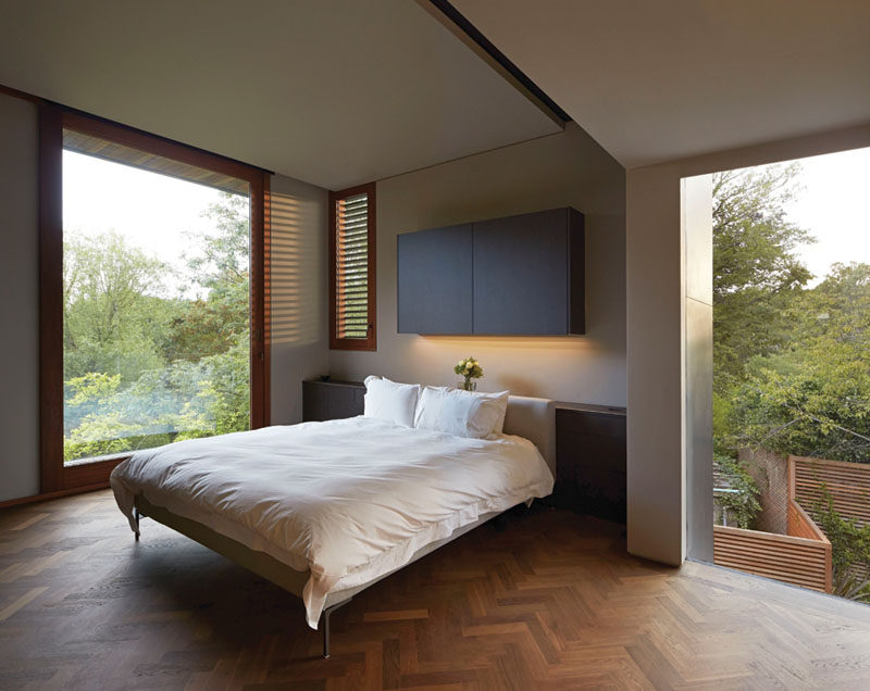 Bedroom Design Idea - 7 Ways To Create A Warm And Cozy Bedroom // Use wood flooring and trim work to add warmth to a room.