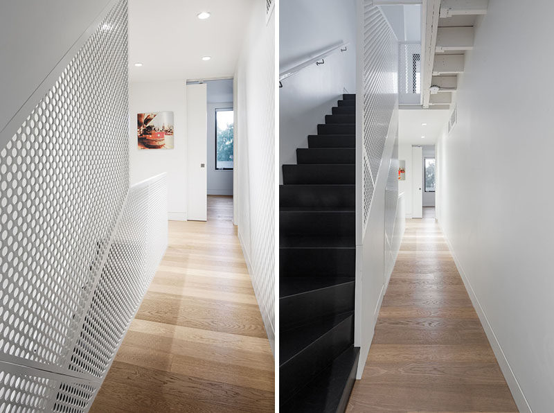 A white mesh steel screen has been used as a safety barrier for these dark stairs.
