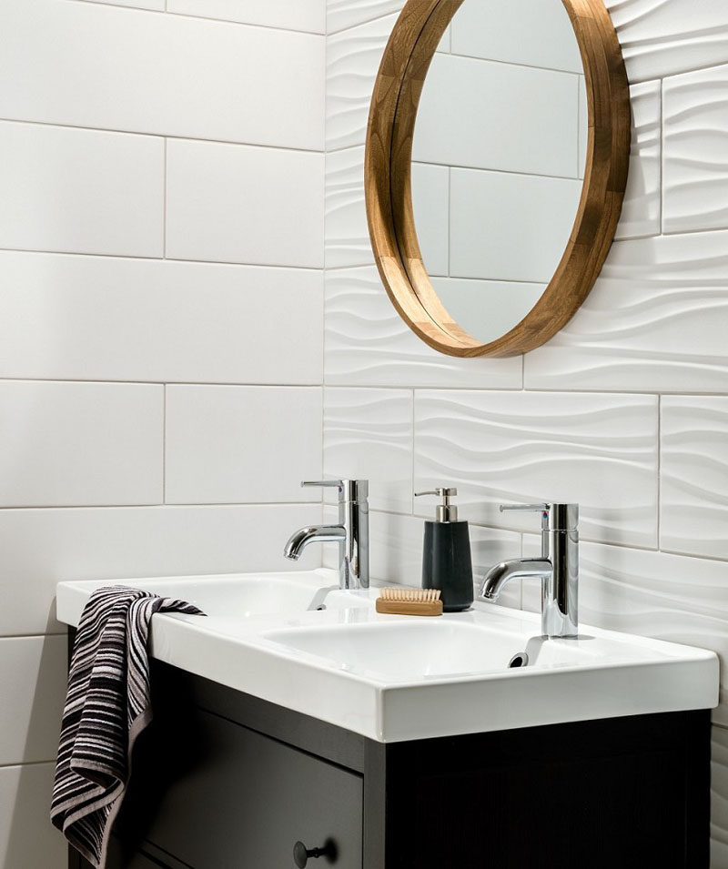 Bathroom Tile Ideas - Install 3D Tiles To Add Texture To Your Bathroom // The ripples in these white bathroom tiles used on one wall add a wave-like look to the wall but are close enough to the style of the flat tiles to make the combination work.