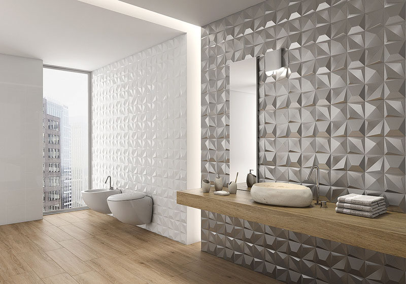 Bathroom Tile Ideas - Install 3D Tiles To Add Texture To Your Bathroom // The metallic tiles on one of these bathroom walls give the bathroom a glamorous feel while the white 3D tiles add a more subtle texture to the walls.
