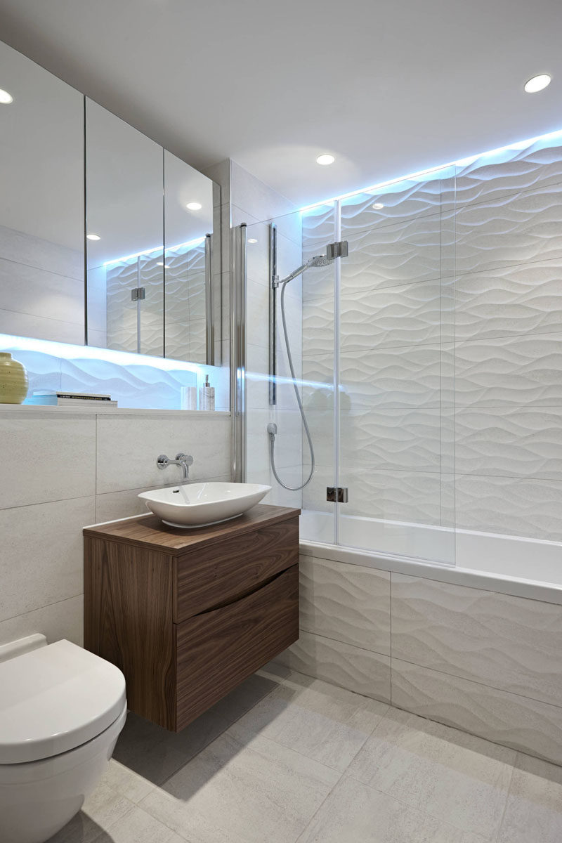 Bathroom Tile Ideas - Install 3D Tiles To Add Texture To Your Bathroom // The cool lights above the wavy tiles make this bathroom look like it's living under water.